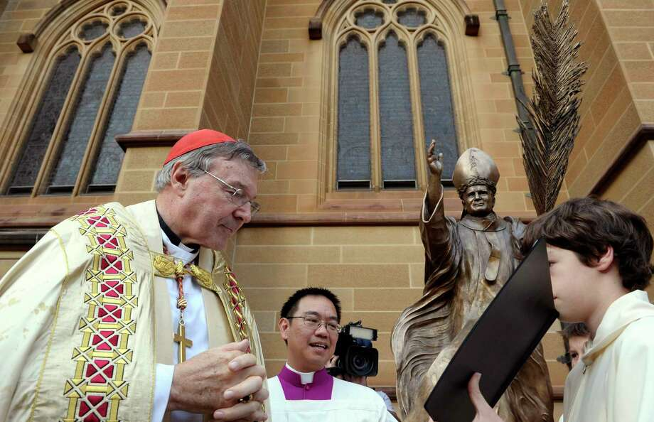 Cardinal George Pell, left, Pope Francis' chief financial adviser, is facing past multiple counts linked to sexual abuse allegations that have plagued the church.  Photo: Rob Griffith, STF / Copyright 2017 The Associated Press. All rights reserved.
