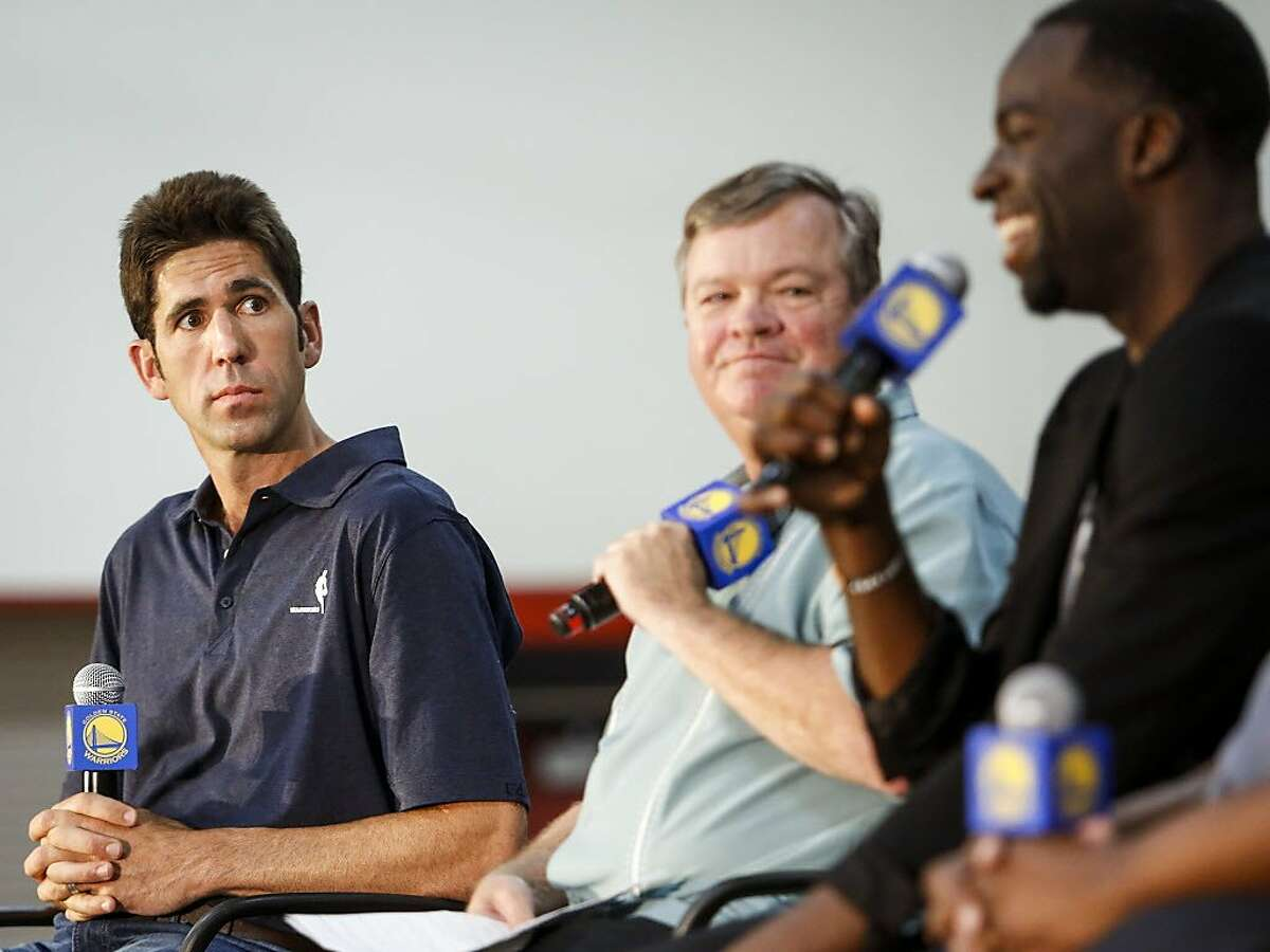 Bob Myers, general manger of the Golden State Warriors, listens to Draymond Green speak during a news conference in the gym of Monte Vista High School, Myer's alma mater, in Danville on Wednesday, June 28, 2017. Monday Draymond Green was announced Defensive Player of the Year and Bob Myers was announced the Executive of the Year by the NBA.