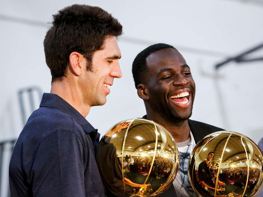 Bob Myers, general manger of the Golden State Warriors, left, and Draymond Green, right, hold up the NBA Championship trophies after a news conference in the gym of Monte Vista High School, Myer's alma mater, in Danville on Wednesday, June 28, 2017. Monday Draymond Green was announced Defensive Player of the Year and Bob Myers was announced the Executive of the Year by the NBA. Photo: Nicole Boliaux, The Chronicle