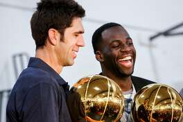 Bob Myers, general manger of the Golden State Warriors, left, and Draymond Green, right, hold up the NBA Championship trophies after a news conference in the gym of Monte Vista High School, Myer's alma mater, in Danville on Wednesday, June 28, 2017. Monday Draymond Green was announced Defensive Player of the Year and Bob Myers was announced the Executive of the Year by the NBA.