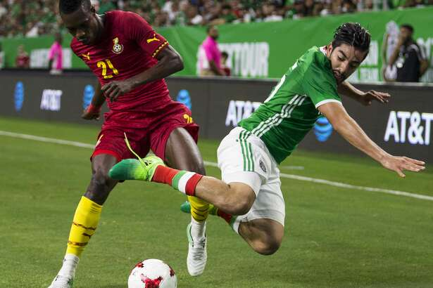 Ghana defender John Boye (21) and Mexico forward Rodolfo Pizarro (15) collide going after a ball near the end line during the first half of an international friendly soccer match at NRG Stadium on Wednesday, June 28, 2017, in Houston. ( Brett Coomer / Houston Chronicle )