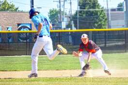 Edwardsville second baseman Zac Crutchfield, right, fields a ground ball in the second inning of Wednesday's game at Belleville East.