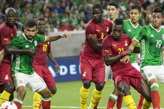 Ghana and Mexico battle for a ball in front of the goal during the first half of an international friendly soccer match at NRG Stadium on Wednesday, June 28, 2017, in Houston. ( Brett Coomer / Houston Chronicle )