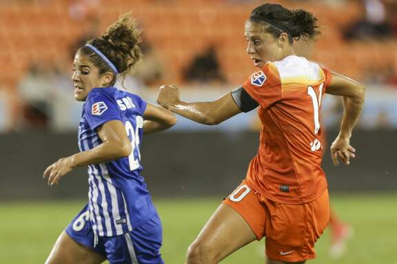 Houston Dash Carli Lloyd (10) breaks away from Boston Breakers midfielder Angela Salem (26) to keep control of the ball during the first half of the game at BBVA Compass Stadium Wednesday, June 28, 2017, in Houston. ( Yi-Chin Lee / Houston Chronicle )