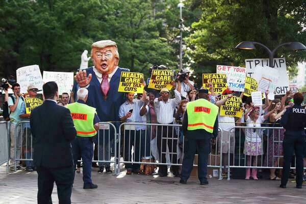 Protesters gather outside the Trump International Hotel in Washington, Wednesday, June 28, 2017, as President Donald Trump arrives at the hotel for fundraiser. (AP Photo/Manuel Balce Ceneta) ORG XMIT: WHMC111