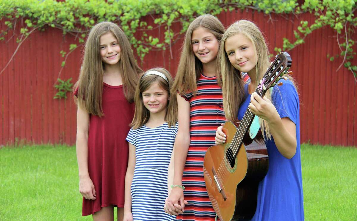The Ginley Sisters are led by the oldest, Katelyn, who plays the guitar.