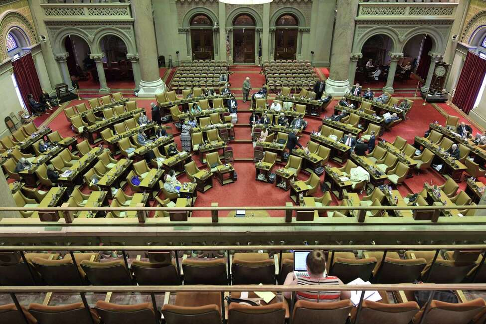 Members of the Assembly and their staff on the floor of the Assembly during a break in the session on Wednesday, June 28, 2017, in Albany, N.Y. (Paul Buckowski / Times Union)