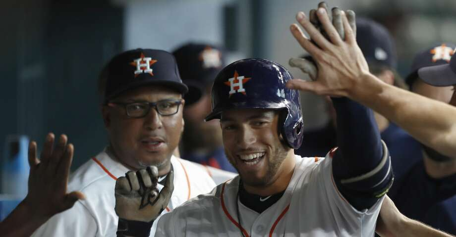 Houston Astros right fielder George Springer (4) celebrates his leadoff home run in the dugout during the first inning of an MLB baseball game at Minute Maid Park, Wednesday, June, 28, 2017.  ( Karen Warren / Houston Chronicle ) Photo: Karen Warren/Houston Chronicle