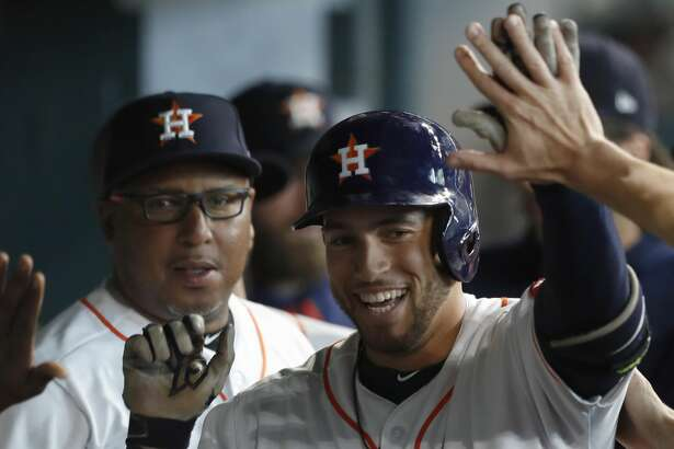 Houston Astros right fielder George Springer (4) celebrates his leadoff home run in the dugout during the first inning of an MLB baseball game at Minute Maid Park, Wednesday, June, 28, 2017.  ( Karen Warren / Houston Chronicle )