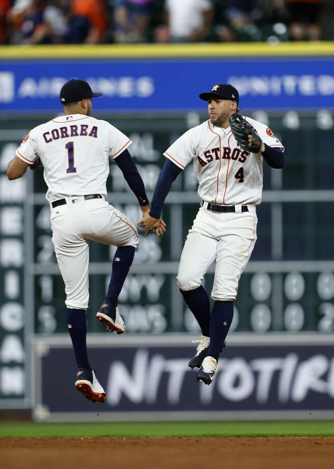 Houston Astros Carlos Correa (1) and George Springer (4) celebrate the Astros 11-8 win over the Oakland Athletics after an MLB baseball game at Minute Maid Park, Wednesday, June, 28, 2017.  ( Karen Warren / Houston Chronicle ) Photo: Karen Warren/Houston Chronicle