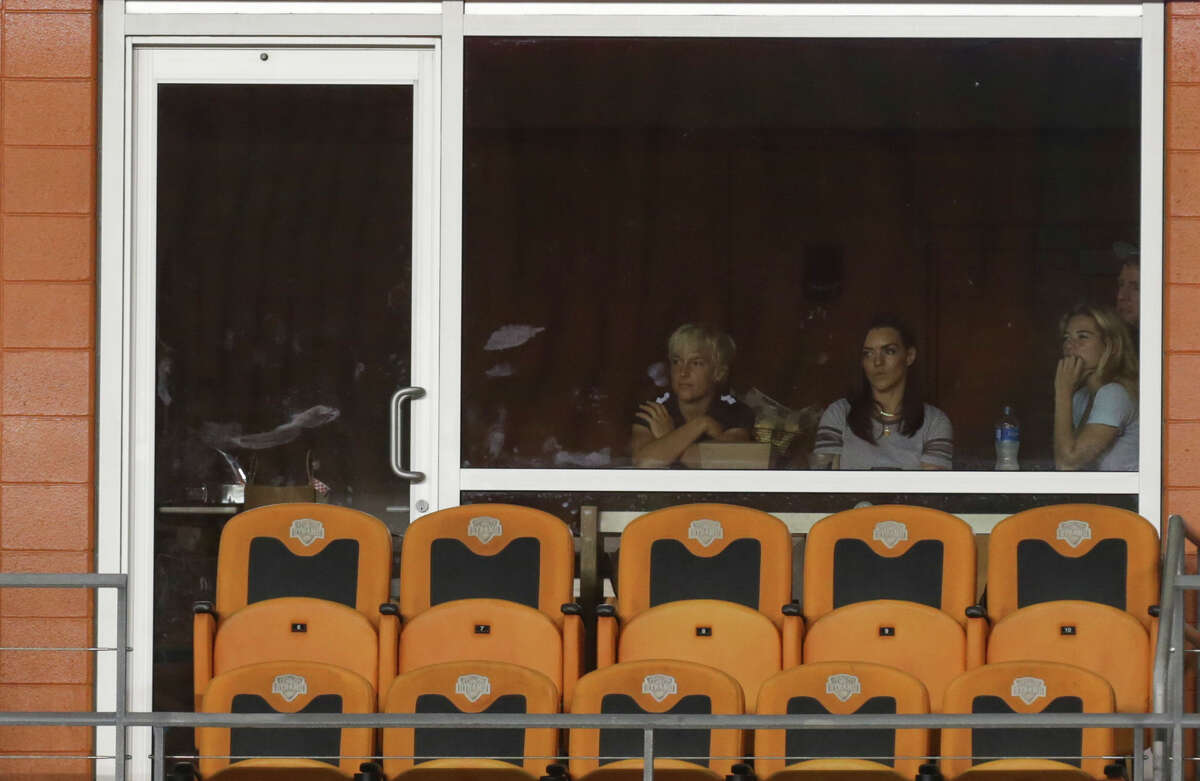 Houston Dash forward Kealia Ohai, right, watches the game from a suit during the second half of the game at BBVA Compass Stadium Wednesday, June 28, 2017, in Houston. Houston Dash and Boston Breakers had a 0-0 draw.( Yi-Chin Lee / Houston Chronicle )