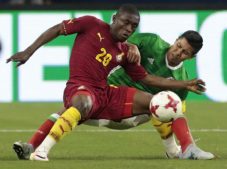 Ghana forward Majeed Abdul Waris (20) and Mexico defender Hugo Ayala (4) get tangled up fighting for the ball during the second half of an international friendly soccer match at NRG Stadium on Wednesday, June 28, 2017, in Houston. ( Brett Coomer / Houston Chronicle ) Photo: Brett Coomer/Houston Chronicle