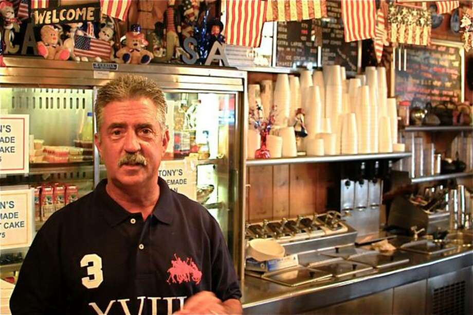 Bob Mazza, owner of the Sugar Bowl on Post Road, poses in his restaurant. Photo: Jim Downey, File Photo / Darien News