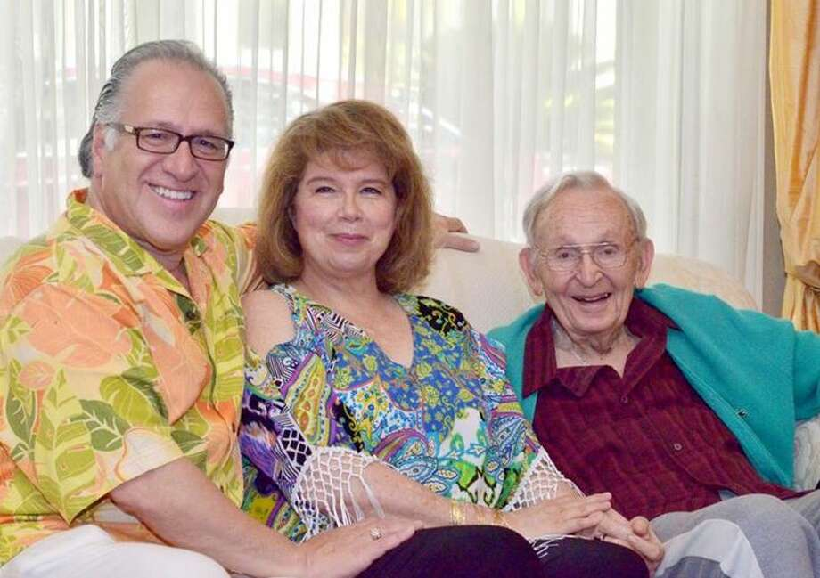 Stanley Keilson poses for a photo with Joe and Teena Arciniega at an intimate tea party held on Wednesday.  Photo: Courtesy