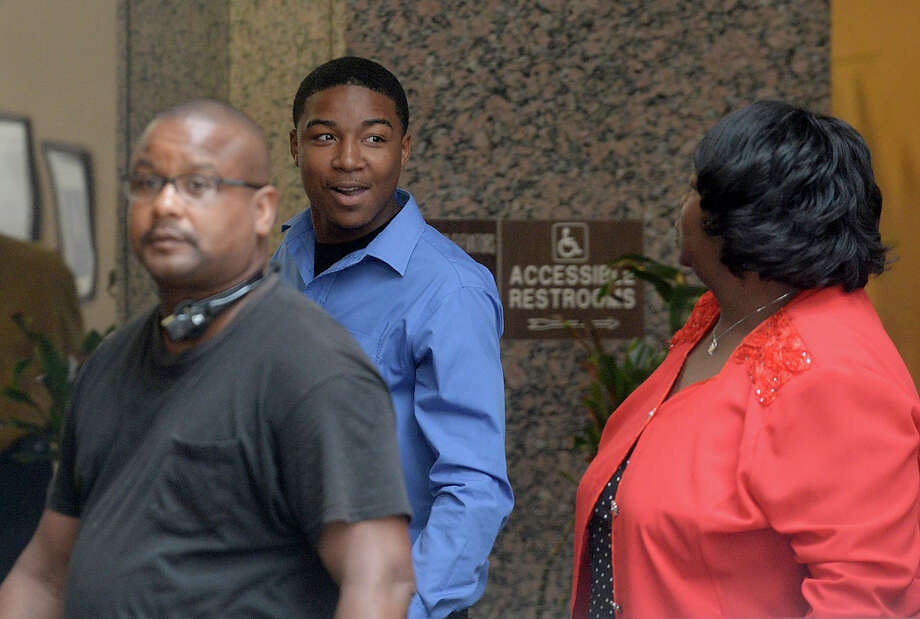Tyrece D'Andre Harris talks with family as they make their way back into Judge John R. Stevens' courtroom for the continuation of his trial Wednesday. Harris is accused of the shooting death of West End resident Jimmy Bertrand and pled not guilty Tuesday. Photo taken Wednesday, June 28, 2017 Kim Brent/The Enterprise Photo: Kim Brent / BEN