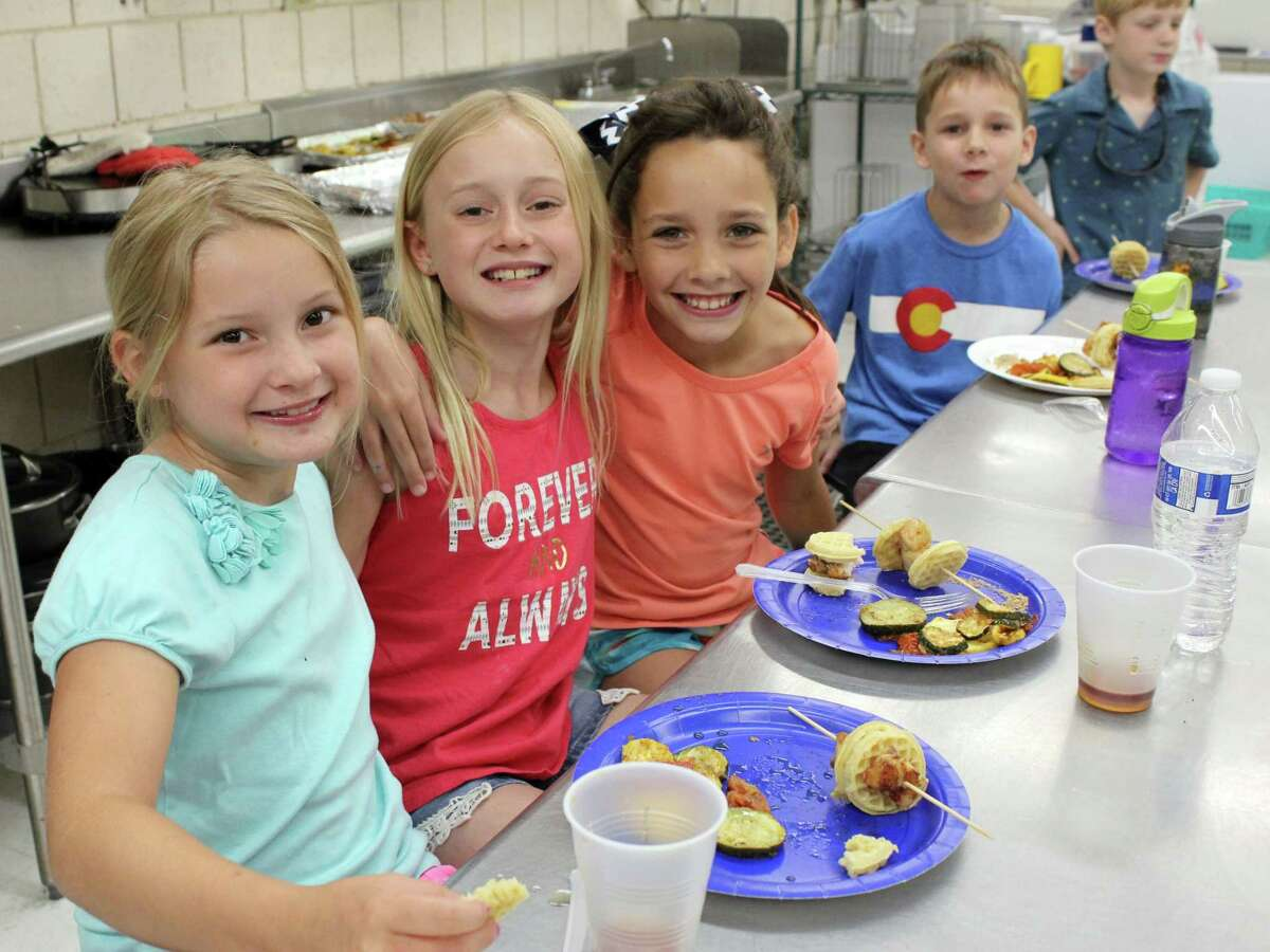 Maddy and Allison Rayment, Piper and Johnny Bittner, and Jack Markey enjoy the lunch they helped prepare at Wilton Continuing Education's Fork, Knife, Spoon and Cooking class on Wednesday, June 28, 2017.