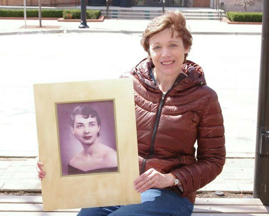 Cindy Lowery holds an earlier photo of her mother, Joan Haskins. Lowery and her family visited Haskins regularly as her health declined. (Niky House/for the Daily News)