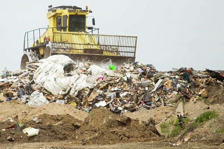 A compactor drives through refuse at the Midland City Landfill on Wednesday. The landfill is not charging for flood victims to dispose of damaged belongings.(Katy Kildee/kkildee@mdn.net)