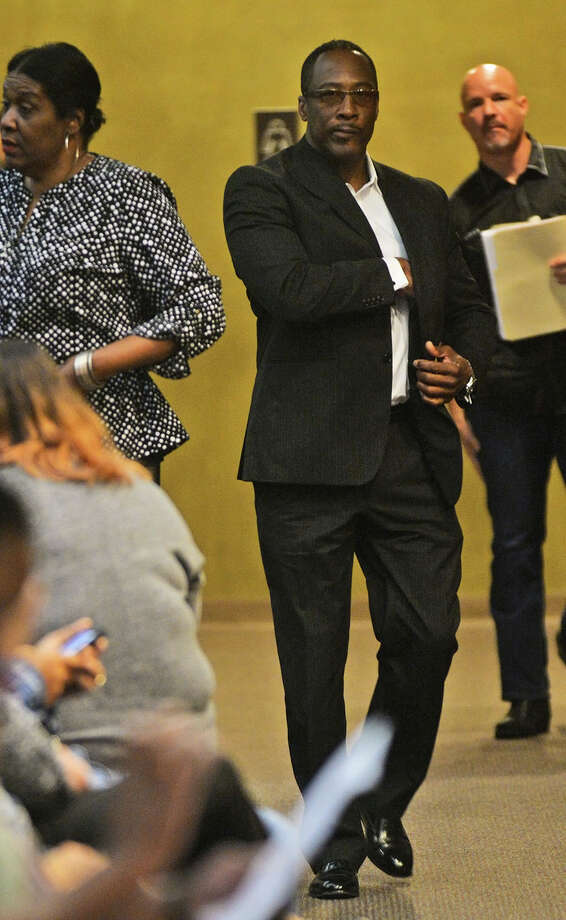 Calvin Walker walks through the Jefferson County Courthouse Monday before his his pre-trial hearing for a 2014 indictment of four counts of fraud and two counts of money-laundering. Photo taken Guiseppe Barranco Guiseppe Barranco/The Enterprise Photo: Guiseppe Barranco, Photo Editor