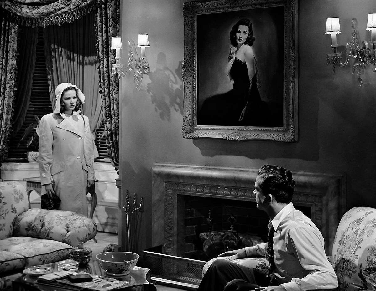 Laura Hunt (Gene Tierney) seen in the flesh (left) and as�idealized image (center portrait) by detective Mark McPherson (Dana Andrews) in Otto Preminger's