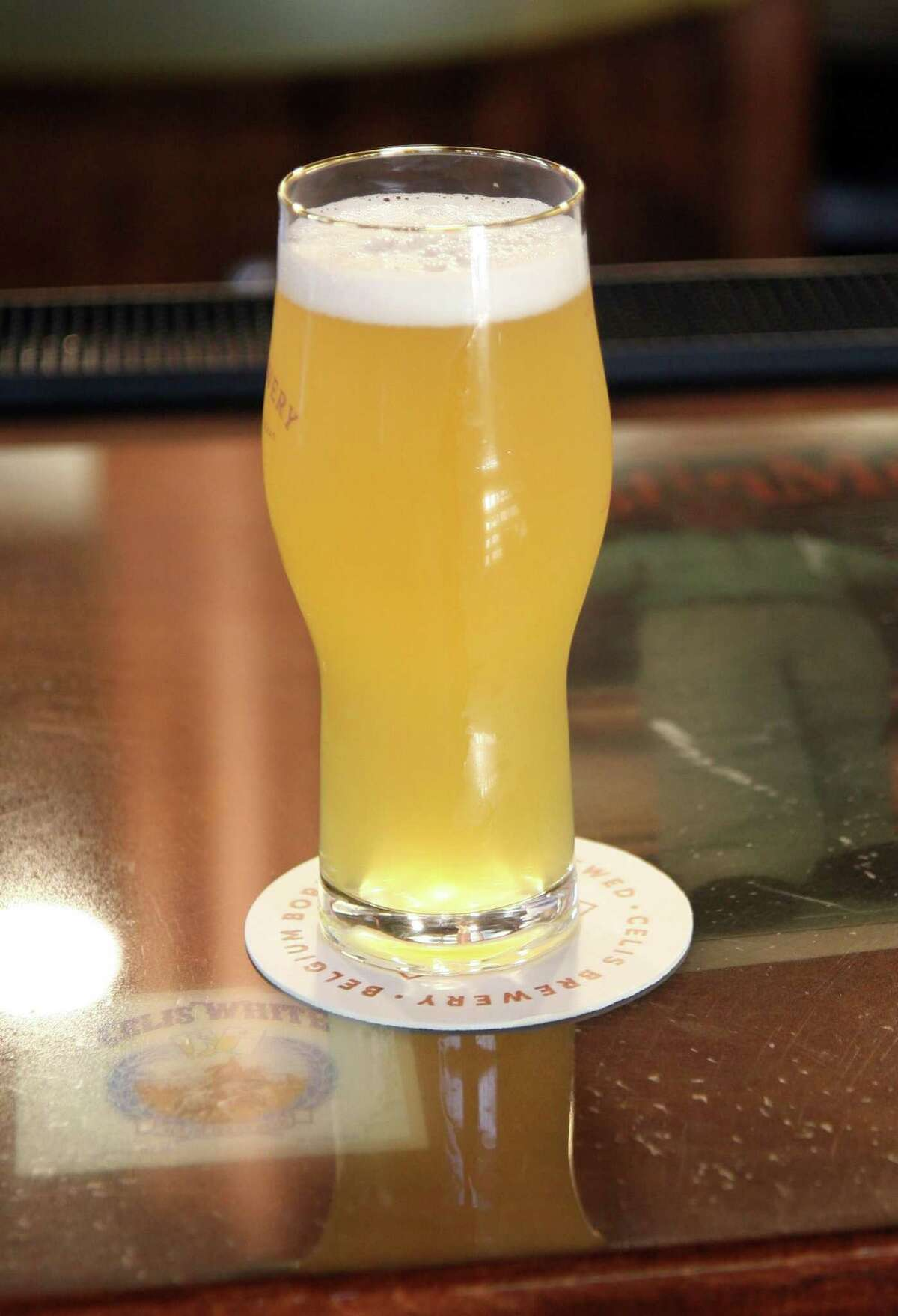 Celis White, a classic Belgian-style witbier, displays its classic straw color, haziness, and thick, bright head.
