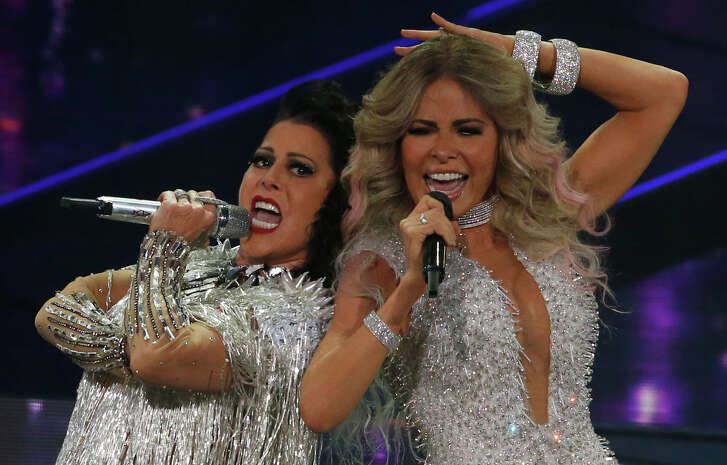 Mexican singers Gloria Trevi, right, and Alejandra Guzman perform in concert at Mexico City Arena in Mexico City, Thursday, June 22, 2017.(AP Photo/Marco Ugarte)