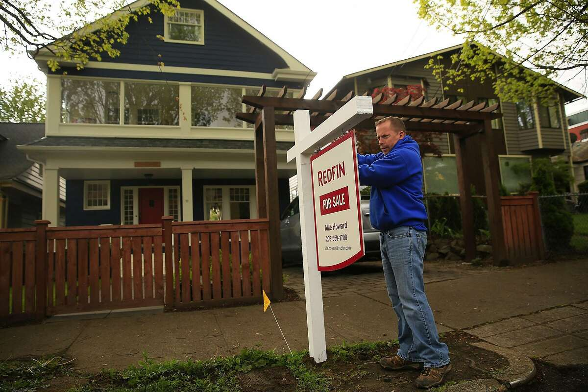 The hot housing markets in Seattle and others like it across the U.S. are leading more homebuyers to bypass the traditional concept of actually seeing, in person, the place they're looking to buy and live in.