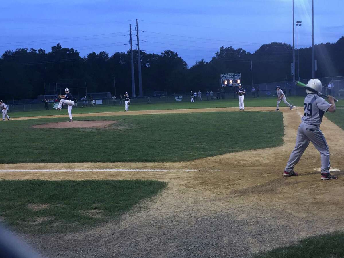 Pitcher Alex Laskin winds and fires to Fairfield National's Pete Crosley Wednesday evening. Fairfield held on to defeat Westport 6-2 in extras.