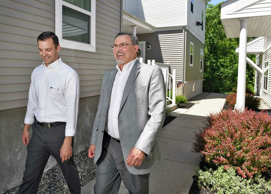 Property Manager Mike Steurer, Left, And Prime Companies Regional Sales  Manager Bob Fisk At