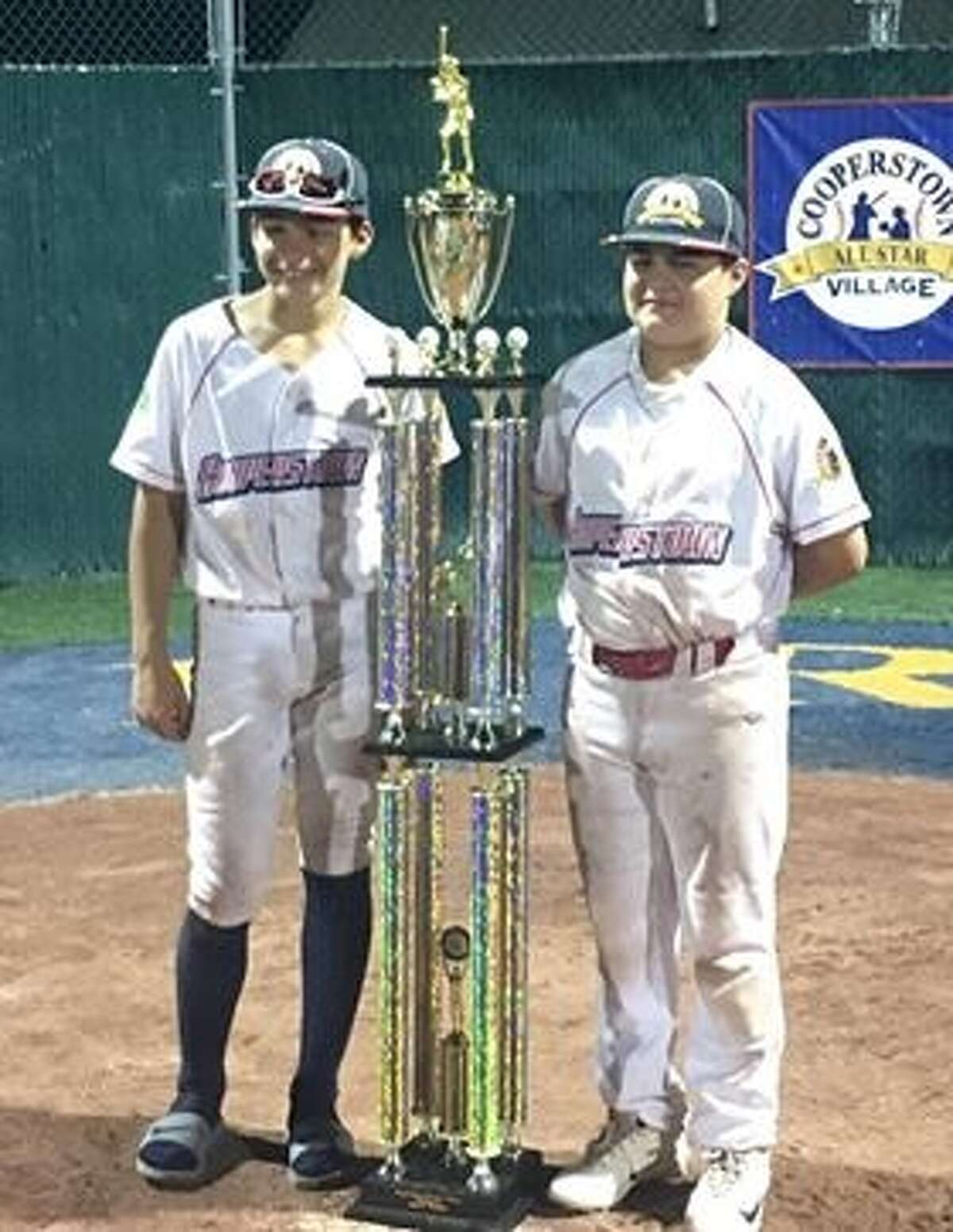 """Ronald �""""Trace�"""" Shirley and Dennis Hollingsworth, both of Tarkington, competed in the Cooperstown Youth World Series June 17-22. Their team went undefeated. They are the sons of Ronald Shirley II and Dennis Hollingsworth, respectively, who both brought home the Dixie Youth World Series title as 12-year-olds in 1989. While competing, the TX Slam team broke the Cooperstown Allstar Village record for most homerooms -- 34 total in 10 games."""