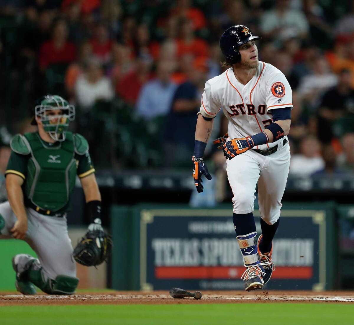 Houston Astros Josh Reddick (22) watches his ball head to the right field wall as Oakland Athletics right fielder Matt Joyce jumped up to haul it in during the first inning of an MLB baseball game at Minute Maid Park, Thursday, June, 29, 2017.