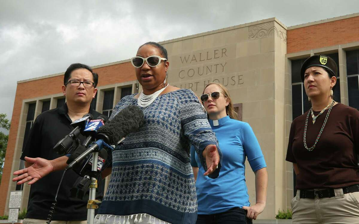 Cynthia Cole, center, board member at the Greater Houston Coalition for Justice, talks about the perjury charges against Brian Encinia being dropped during a press conference outside the Waller County Courthouse Thursday, June 29, 2017, in Hempstead. State District Judge Albert McCaig Jr. dismissed the misdemeanor perjury charge against Encinia, a former state trooper, who stopped Sandra Bland on a Waller County road for an improper lane change in 2015.