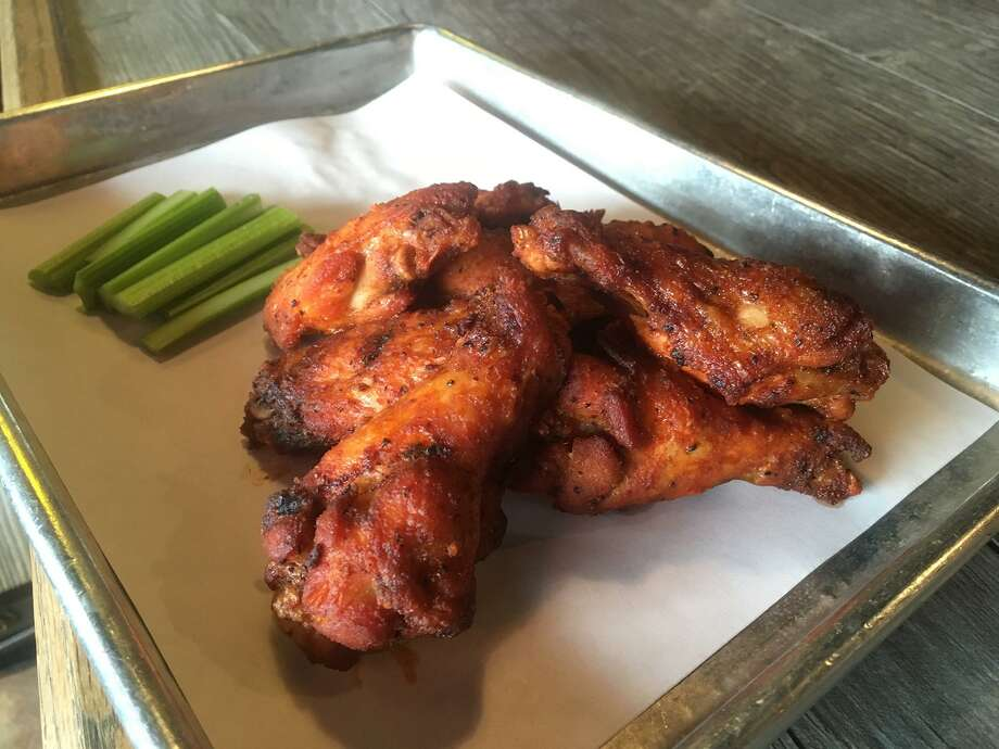 The Pigpen at 106 Pershing Ave. sells about 100 pounds of smoked chicken wings per week, and it is one of the more popular item on the mostly finger food menu. An order of six sells for $8.08. Photo: Chuck Blount / San Antonio Express-News