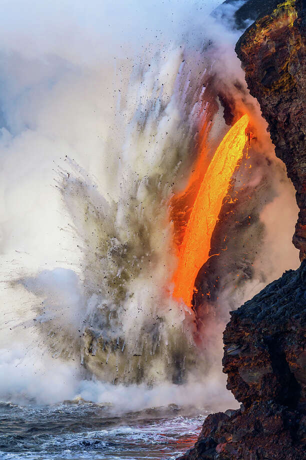 This past January, a steady stream of lava, called a firehose, suddenly gushed from an underground lava tube at the base of Hawai'i's Kilauea volcano and spilled into the Pacific Ocean. As the molten rock met the cooler seawater, steam, sand, and chunks of cooled lava were thrown explosively into the air. The impact of these continual bursts of energy eventually created a crack in the 90-foot sea cliff, which expanded over the course of a week until a section of the cliff broke off entirely and sloughed into the sea. Photo: Jon Cornforth