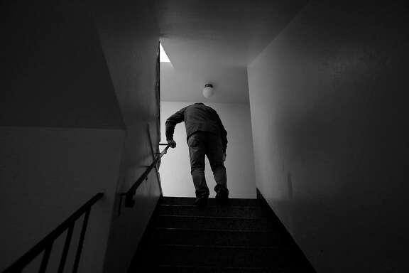 Luis Castellano makes his way up a flight of stairs to his apatment on Friday, April 14, 2017 in San Francisco, Calif.