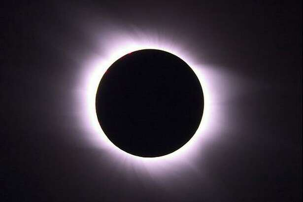 """The """"solar corona"""" will pop out at you when the moon completely blocks the sun and day turns into night … The solar corona is the upper atmosphere of the sun, which you normally can't see because of either vampirism or, more likely, because the rest of the sun is just to darn bright."""