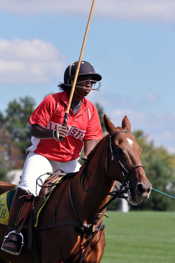 This undated photo provided by the Work to Ride program shows 19-year-old Shariah Harris playing polo at the Polo Club in Lancaster, Pa. Harris, who grew up in single-parent home just outside of west Philadelphia, is set to become the first African American woman to play in a top-tier U.S. polo event when she mounts up Friday, June 30, 2017, for the Postage Stamp Farm polo team in the Silver Cup at the tony Greenwich Polo Club in Connecticut. (Lezlie Hiner/Work to Ride via AP) Photo: Lezlie Hiner, Associated Press