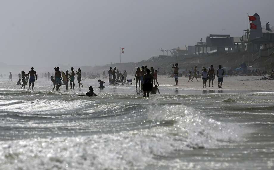 Southern coastal communities such as Seaside, Fla., are likely to feel the greatest impact of global warming, researchers say. Photo: Kiichiro Sato, Associated Press