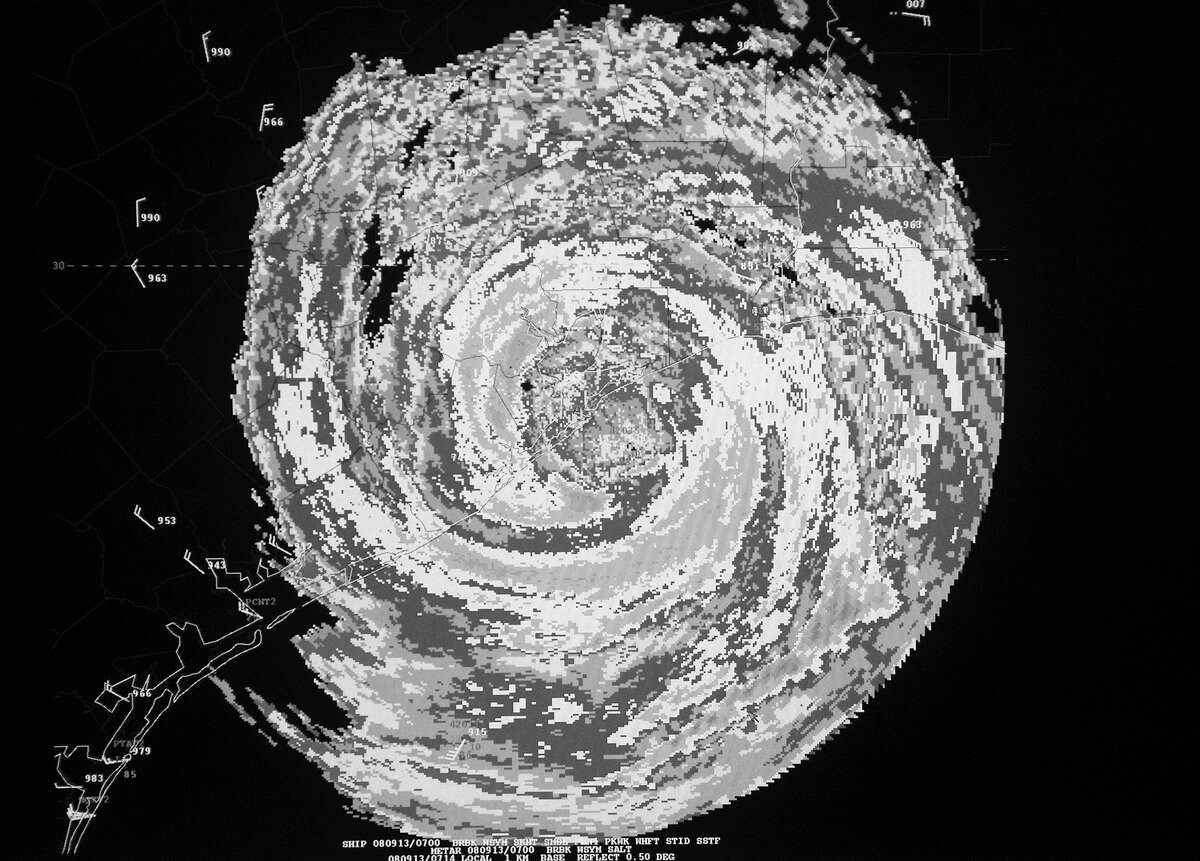 A video monitor at the National Hurricane Center in Miami shows an enhanced radar image of Hurricane Ike as it came ashore at Galveston on Sept. 13, 2008. Had the storm drifted to the west, the consequences for our region would have been catastrophic.