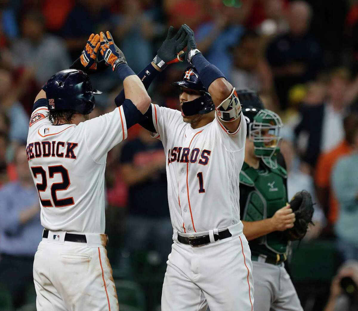 Houston Astros Carlos Correa (1) celebrates his two-run home run with Josh Roddick (22) during the fourth inning of an MLB baseball game at Minute Maid Park, Thursday, June, 29, 2017.