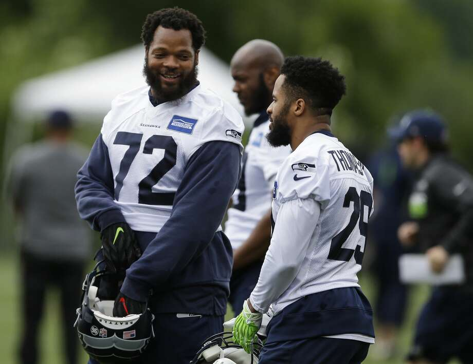 RETRANSMISSION TO CORRECT DAY - Seattle Seahawks defensive end Michael Bennett, left, talks with free safety Earl Thomas, right, during NFL football practice, Tuesday, June 13, 2017, in Renton, Wash. (AP Photo/Ted S. Warren) Photo: Ted S. Warren/AP
