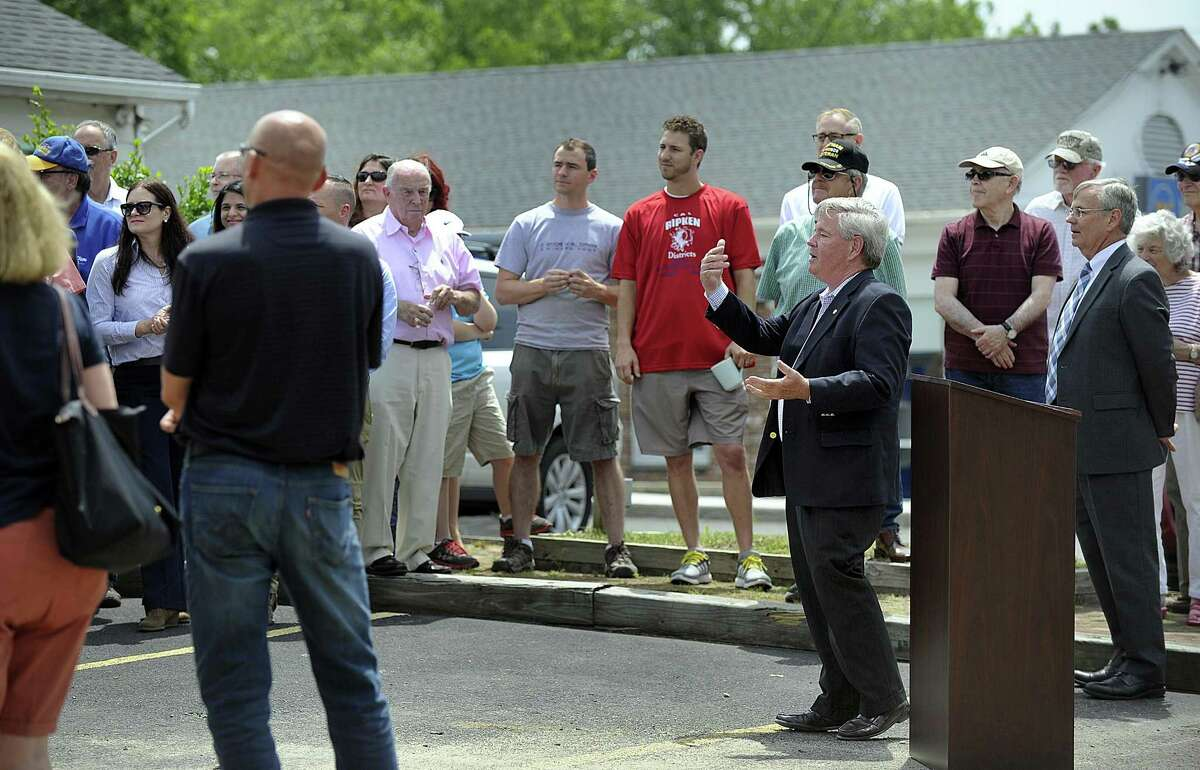 Stephen Dunn, First Selectman of Brookfield, addresses a gathering for the official groundbreaking for the Brookfield Four Corners streetscape project, Thursday, June 29, 2017.