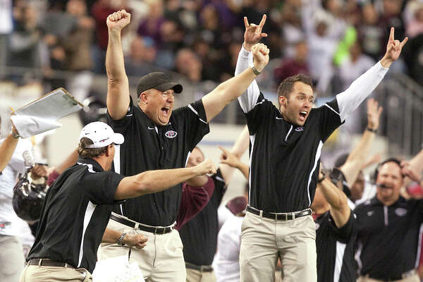James Farmer (center) will try to keep Pearland's lengthy playoff streak intact as he serves as the Oilers' head football coach for the 2017 season. Farmer begins his 14th season on the Pearland staff this fall.