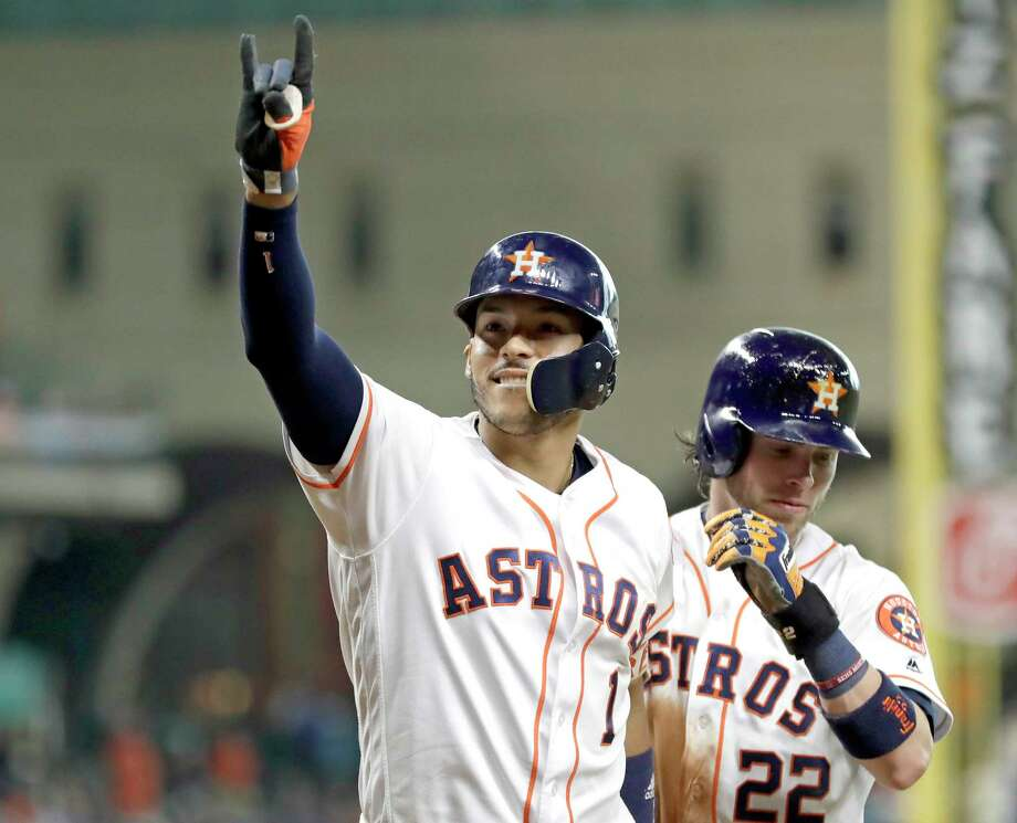 Houston Astros' Carlos Correa (1) celebrates with Josh Reddick (22) after both scored on Correa's home run against the Oakland Athletics during the fourth inning of a baseball game Thursday, June 29, 2017, in Houston. (AP Photo/David J. Phillip) Photo: David J. Phillip, STF / Copyright 2017 The Associated Press. All rights reserved.