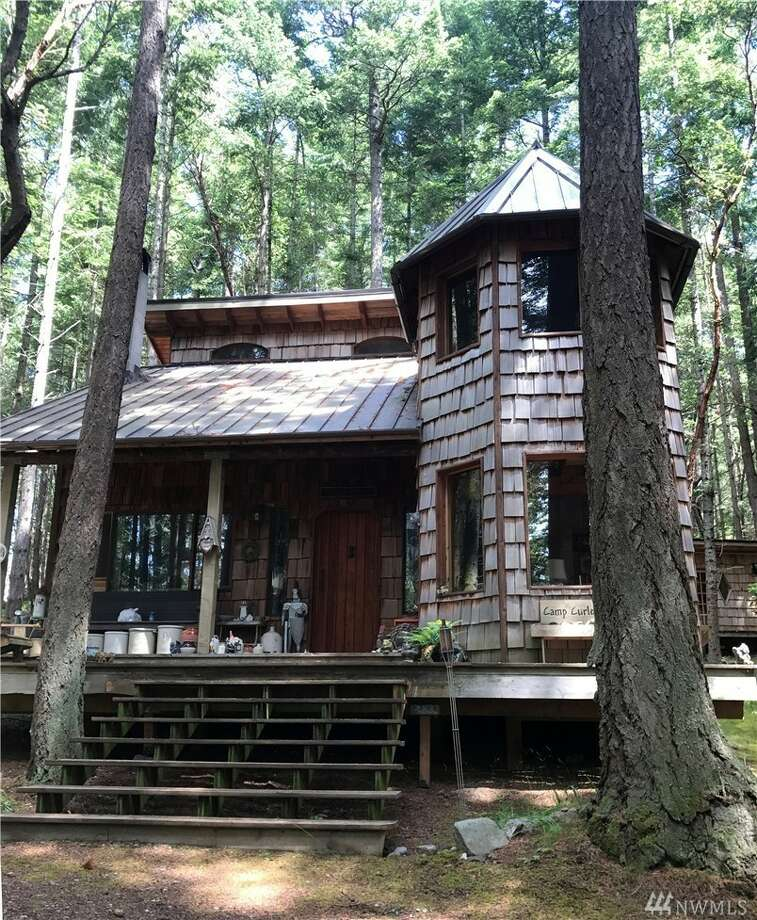 The first structure on the property is this log cabin home with a turret. The 1.65-acre property has three buildings and is listed for $289,000.You can see the full listing here. Photo: Photos Courtesy Of Kelly Snow, Coldwell Banker San Juan Isand