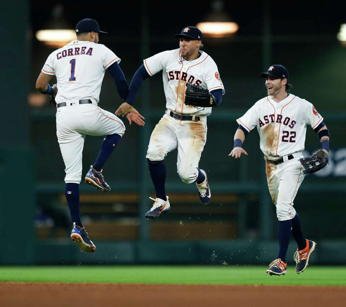 Houston Astros Carlos Correa (1), George Springer (4), and Josh Reddick (22) celebrate the Astros 6-1 win over the Oakland Athletics after an MLB baseball game at Minute Maid Park, Thursday, June, 29, 2017.