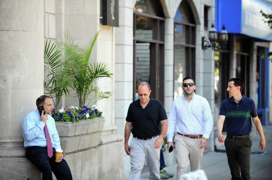 Workers walk down Atlantic Street, in downtown Stamford, Conn. on Wednesday, June 21, 2017. Photo: Michael Cummo / Hearst Connecticut Media / Stamford Advocate