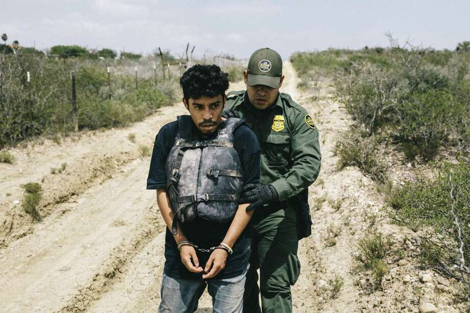 Border Patrol agent Christian Salmon apprehends a Honduran national who crossed the Rio Grande in an inflatable raft near Roma, Texas, May 15, 2017. Some readers suggest that we take too narrow a view of undocumented immigrants. Photo: WILLIAM WIDMER /NYT / NYTNS