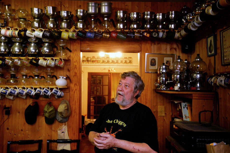 Steven Lewis stands in his kitchen with some of his  collection of over 700 vacuum coffee pots that line custom shelving around his Beaumont home. Lewis started collecting after moving into his grandparents' former home and finding one in the attic.  Photo taken Tuesday 6/13/17 Ryan Pelham/The Enterprise Photo: Ryan Pelham / ©2017 The Beaumont Enterprise/Ryan Pelham