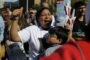 Maria Moreno and her son, Ivan Hernandez, join thousands of people in support of Deferred Action for Childhood Arrivals (DACA) and Deferred Action for Parents of Americans (DAPA) during the conclusion of a three-day march from Hutto to the Texas Governor's Mansion in November 2015. Thursday, Attorney General Ken Paxton called on the Trump administration to begin phase out DACA, which shielded from deportation certain undocumented immigrants who were brought the country as children.
